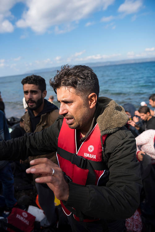 Near the town of Skala Sikamineas on the Greek island of Lesbos, a man is overcome with emotion moments after arriving in a crowded inflatable boat from Turkey. He is traveling with his wife and children (not pictured).