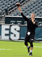 Philadelphia Eagles quarterback Carson Wentz tosses a football before the start of the Eagles - Browns football game September 11, 2016 at Lincoln Financial Field in Philadelphia, Pennsylvania.  (Photo by William Thomas Cain)