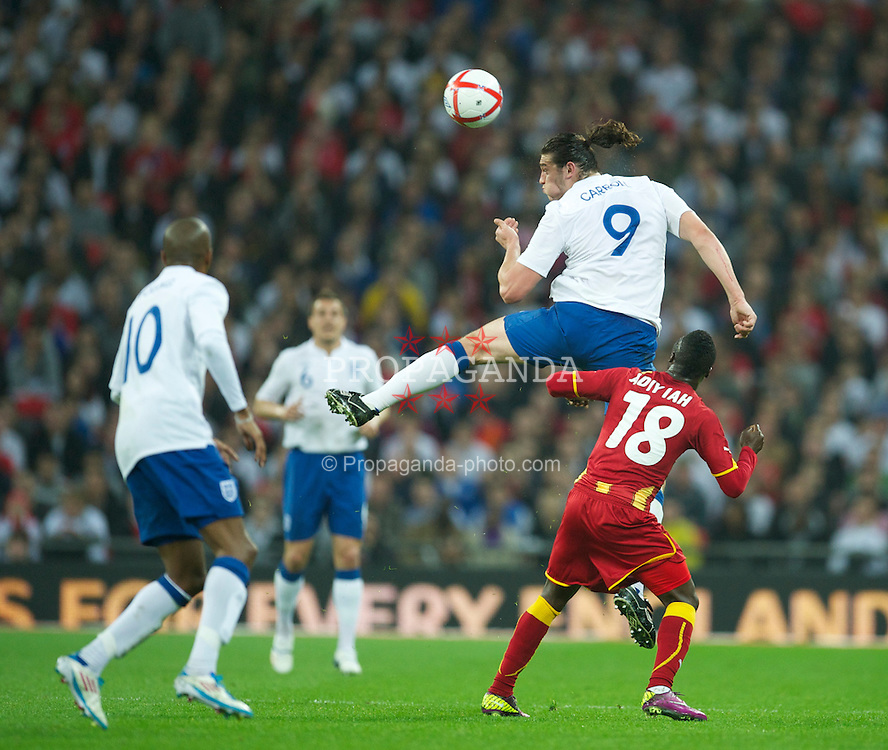 LONDON, ENGLAND - Tuesday, March 29, 2011: England's Andy Carroll in action against Ghana's Dominic Adiyiah during the international friendly match at Wembley Stadium. (Photo by David Rawcliffe/Propaganda)