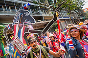01 FEBRUARY 2014 - BANGKOK, THAILAND: Anti-government protestors dance to Thai country music in the Chinatown section of Bangkok. The anti-government protest movement, led by the People's Democratic Reform Committee (PDRC) organized a march through the Chinatown district of Bangkok Saturday and disrupted the city's famous Chinese New Year festival. Some streets were blocked and protest leader Suthep Thaugsuban walked through the neighborhood collecting money. The march was in advance of massive protests the PDRC has promised for Sunday, Feb. 2 in an effort to block Thais from voting in the national election.     PHOTO BY JACK KURTZ
