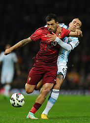 Portugal's Danny is fouled by Argentina's Nicolas Otamendi  - Photo mandatory by-line: Joe Meredith/JMP - Mobile: 07966 386802 - 18/11/14 - SPORT - Football - Manchester - Old Trafford - Argentina v Portugal - International Friendly