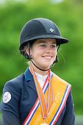 Lisa Nooren en Royalty des Isles Nederlands Kampioen Junioren en met Flying Saucer das Umburanas Nederlands Kampioen Young Riders<br /> CH Mierlo 2014<br /> © DigiShots
