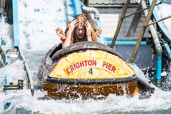 © Licensed to London News Pictures. 30/06/2019. Brighton, UK. Members of the public cool down by taking a ride on the Brighton Palace Pier water attraction Wild River in Brighton and Hove on one of the hottest days of the year so far. Photo credit: Hugo Michiels/LNP