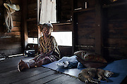 "RANONG PROVINCE,SOUTHERN THAILAND,AUGUST 2012: A moken woman moans the death of her son who died from decompression sickness while diving for sea cucumbers. She hasn't spoken ever since.<br /> The Moken are a nomadic sea people who live in and around southern Thailand, traditionally feeding of the fruits of the sea for eight months a year. But the 2004 Indian Ocean tsunami destroyed many livelihoods, and the Moken were forced onto the land.<br /> Brought to the world's attention by the natural disaster, the seafaring tribe is struggling to reconcile tradition and modernity, leaving behind their ""sea gypsy"" life for a modern existence"