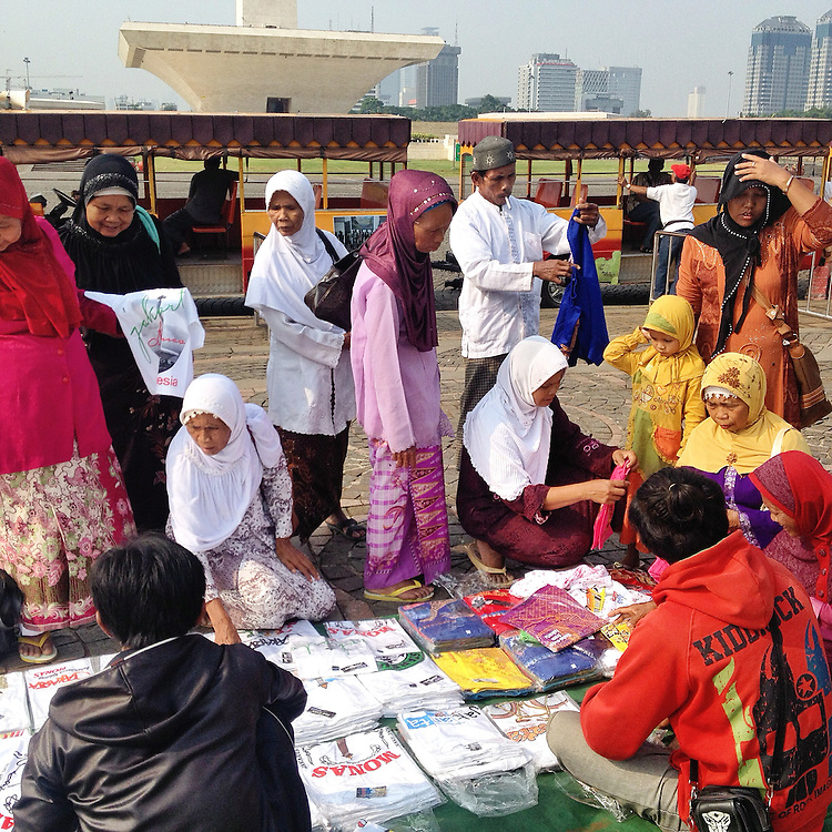 """Visitors shop for """"Oleh-oleh"""" or souvenirs at Monas Square to bring back for their family and friends."""
