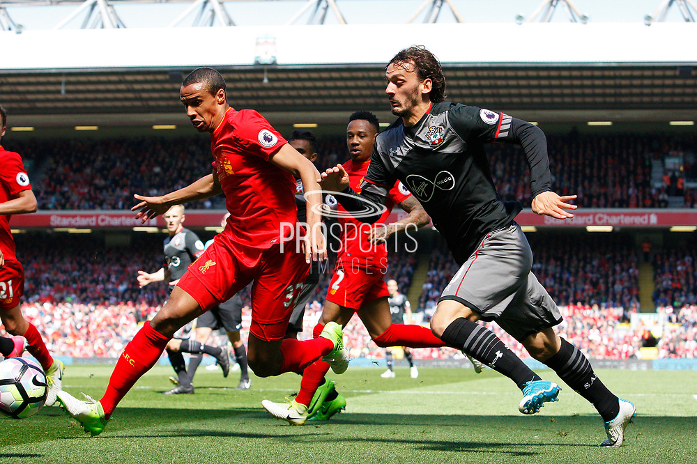Southampton's Manolo Gabbiadini (20) and Joel Matip (32) of Liverpoo during the Premier League match between Liverpool and Southampton at Anfield, Liverpool, England on 7 May 2017. Photo by Craig Galloway.