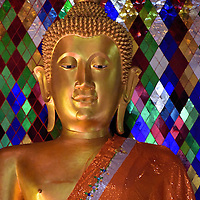 Close Up of Buddha Statue at Wat Chamthewi in Lamphun, Thailand <br />