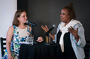 "Reporter Lindsay Christians and chef Nyanyika Banda talk during the live recording of the ""Corner Table Podcast"" at Old Sugar Distillery in Madison, Wisconsin, Tuesday, June 18, 2019."