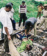 BANGALORE,1998.<br /> Constables collect the mangled remains of an unidentified man around 30 years of age, who jumped onto the railway tracks in Yeshwantpur.On an average, three people are run over a day by speeding trains in Bangalore.