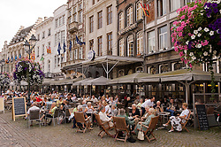 Patrons enjoy dinning outdoors at the many restaurants and cafes that line the Grote Markt or main square, in the city center of Mechelen, Belgium, Thursday, Sept. 11, 2008. (Photo © Jock Fistick)