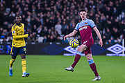 Declan Rice (West Ham) with the ball and Nicolas Pepe (Arsenal) in the background during the Premier League match between West Ham United and Arsenal at the London Stadium, London, England on 9 December 2019.