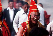 The Dalai Lama, Tibet's God King, smiles after performing a puja in Dharamsala,India.©1986