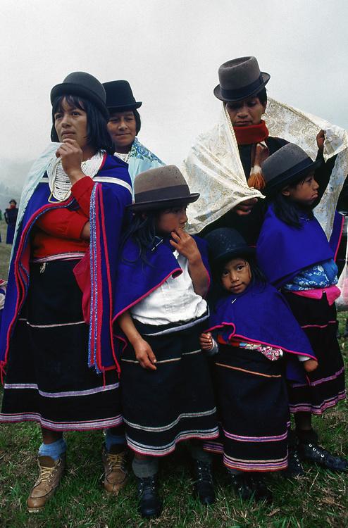 ca. 1980-1995, Colombia --- Guambiano Indians stand in rain shower, Silvia, Cauca, Colombia. | Location: Silvia, Cauca, Colombia. --- Image by © Jeremy Horner/Corbis