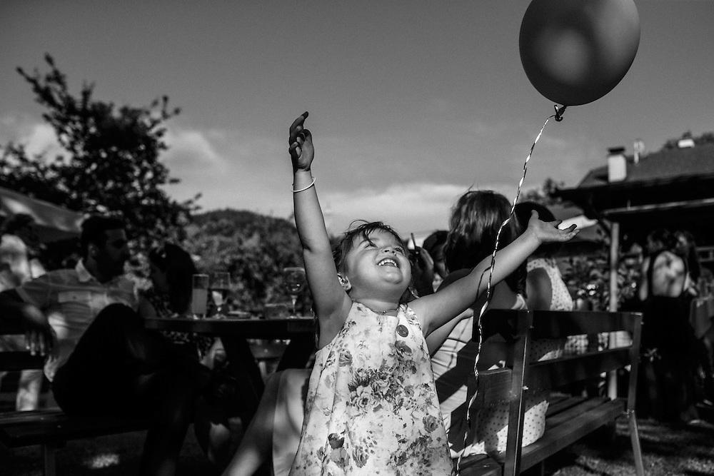Karlina, my niece, loves playing with balloons. Wedding of Simon Posar and Špela Magajna.