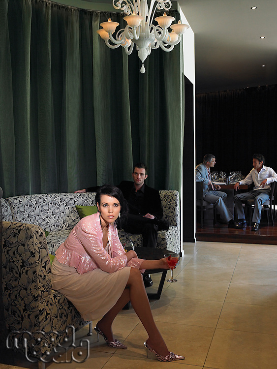 Woman sitting on couch in hotel lobby