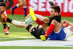 March 9, 2019 - Vancouver, BC, U.S. - VANCOUVER, BC - MARCH 10: Sam Dickson #7 of New Zealand tumbles in to score despite France defender tackle during Game #4- New Zealand 7s vs France 7s in Pool C match-up at the Canada Sevens held March 9-10, 2019 at BC Place Stadium in Vancouver, BC, Canada.(Photo by Allan Hamilton/Icon Sportswire) (Credit Image: © Allan Hamilton/Icon SMI via ZUMA Press)