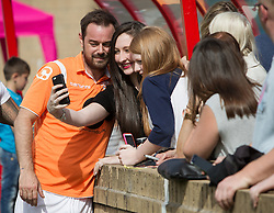 © Licensed to London News Pictures . 02/08/2015 . Droylsden Football Club , Manchester , UK . DANNY DYER poses with fans . Celebrity football match in aid of Once Upon a Smile and Debra , featuring teams of soap stars . Photo credit : Joel Goodman/LNP