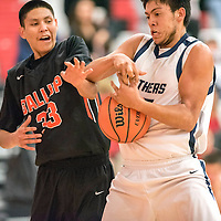 121914  Adron Gardner/Independent<br /> <br /> Gallup Bengal Matthew Begay (33), left, ties up with Piedra Vista Panther Dillon Mason (45) during the Eddie Peña Holiday Classic in Grants Friday.