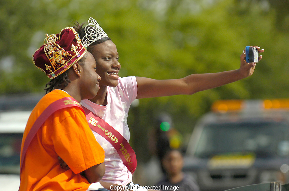 Jodi Miller Lubbock Avalanche-Journal.Miss Juneteenth Kanesaha Waritay, right, and Mr. Juneteenth Alexander Johns capture their day of royalty on a disposable camera before the start of the Juneteenth Freedom parade Saturday morning.