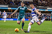 Wigan Athletic defender Jake Buxton (3), Queens Park Rangers defender Jake Bidwell (3) during the EFL Sky Bet Championship match between Queens Park Rangers and Wigan Athletic at the Loftus Road Stadium, London, England on 21 February 2017. Photo by Sebastian Frej.