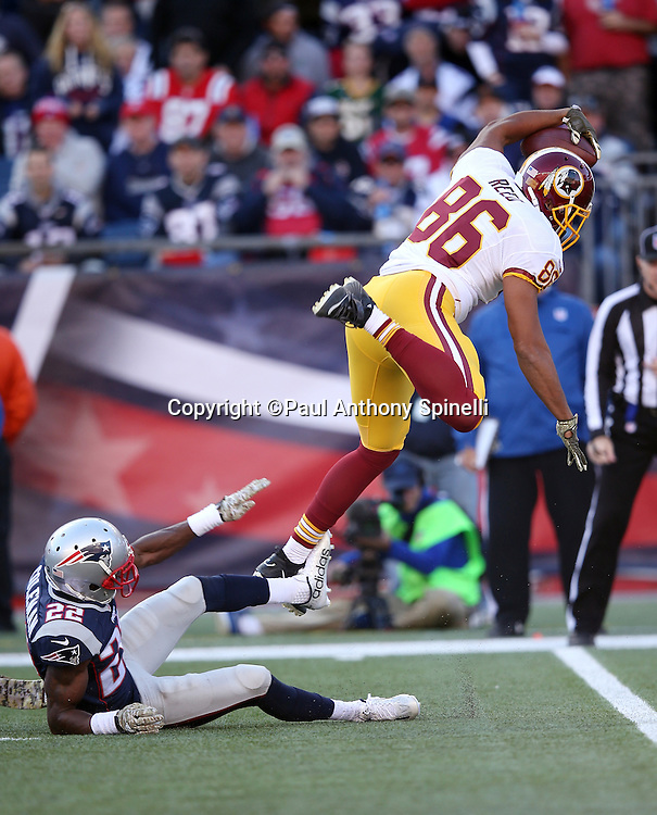 Washington Redskins tight end Jordan Reed (86) gets tripped up by New England Patriots cornerback Justin Coleman (22) as he catches a second quarter pass for a gain of 6 yards during the 2015 week 9 regular season NFL football game against the New England Patriots on Sunday, Nov. 8, 2015 in Foxborough, Mass. The Patriots won the game 27-10. (©Paul Anthony Spinelli)