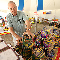 Bobby Tackett gets packages of TNT Fireworks sorted on the sales table Monday in Saltillo for their Fouth of July customers. The sales from the Fireworks tents on Highway 145 in Saltillo near Insustrial Park Road and the Fred's location are fundraisers for Faimily Christian Center Church in Guntown.