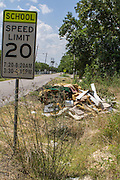 There is another dumping ground on a sidewalk next to a school zone sign on Bacher near Tate. Students will not be able to walk to the school without entering the flow of traffic.