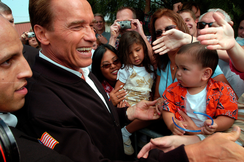 "Santa Clarita, CA, USA, Oct. 10th 2003: Arnold Schwarzenegger continued his ""California Comeback Express"" campaign tour troughout California in his attemt to perusade the californians to vote for recall of Gray Davis and elect the actor as the new Governor of California.<br /> <br /> At the Pueblo Building Materials Factory, 15 months old Maxwell Shochette looks on while Arnold Schwarzenegger greets his supporteres. <br /> <br />  *** Local Caption *** , posted on Corbis web ,"