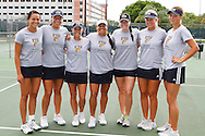 FIU Tennis Senior Day.  Liset Brito and Maria Spenceley recieve their senior gifts from Coach Applebaum.  The game was suspended due to rain. Senior Gifts provided by Roy Viera.