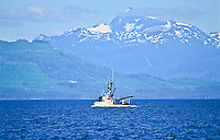 A fishing troller in Stephens Passage.  Southeast Alaska.