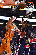 Apr 1, 2016; Phoenix, AZ, USA; Phoenix Suns forward Mirza Teletovic (35) makes a pass over Washington Wizards center Nene (42) in the second half at Talking Stick Resort Arena. the Washington Wizards won 106-99.  Mandatory Credit: Jennifer Stewart-USA TODAY Sports