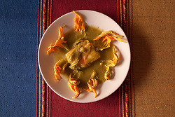 North America, Mexico, Oaxaca Province, Oaxaca, tortillas in mole sauce with squash blossoms
