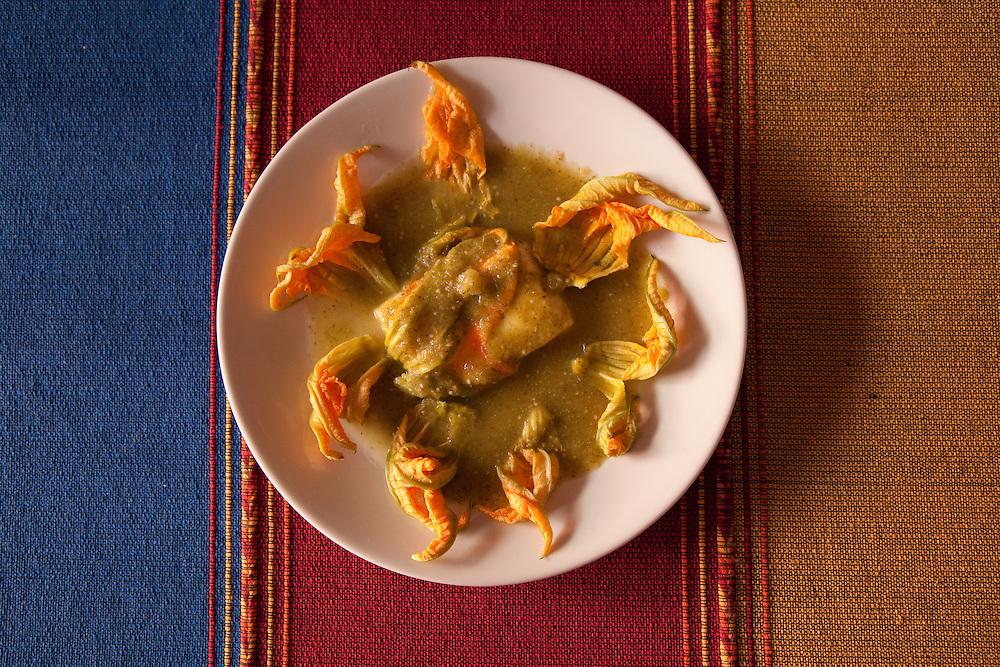 North America, Mexico, Oaxaca Province, Oaxaca, tortillas in mole sauce with squash blossoms
