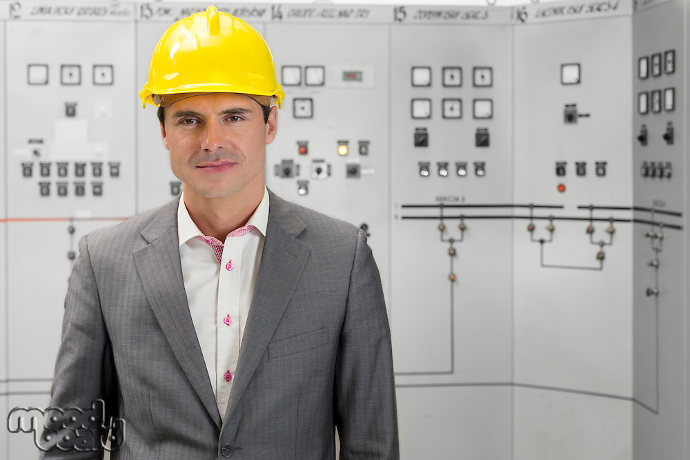 Portrait of confident young male supervisor in control room