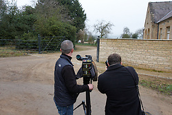© Licensed to London News Pictures.  13/03/2012. CHIPPING NORTON, UK. Members of the media outside the home of Rebekah Brooks, former News of the World editor, and husband Charlie Brooks, taken today from a public bridalway. Both are thought to have been arrested this morning on suspicion of conspiracy to pervert the course of justice as part of Operation Weeting looking into phone hacking.  Photo credit :  Cliff Hide/LNP