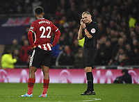 Football - 2019 / 2020 Premier League - Tottenham Hotspur vs. Sheffield United<br /> <br /> Referee Graham Scott waits on VAR which ruled out David McGoldrick's goal, at Tottenham Hotspur Stadium.<br /> <br /> COLORSPORT/ASHLEY WESTERN