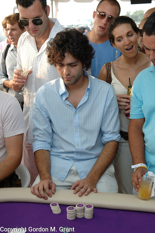 Bridgehampton, NY - 8/13/05 - Actor Adrian Grenier of the HBO show &quot;Entourage&quot; plays poker in the YAHOO Games tent at The Mercedes Benz Polo Challenge at The Bridgehampton Polo Club in Bridgehampton, NY August 13, 2005.     (Photo by Gordon M. Grant / Zuma Press)<br />