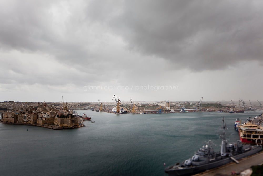 26 February 2011. Valletta, Malta. The harbor in Valletta, Malta, where ferries and ships docked after evacuating people from strife-torn Libya.<br /> <br /> &copy;2011 Gianni Cipriano<br /> cell. +1 646 465 2168 (USA)<br /> cell. +39 328 567 7923<br /> gianni@giannicipriano.com<br /> www.giannicipriano.com
