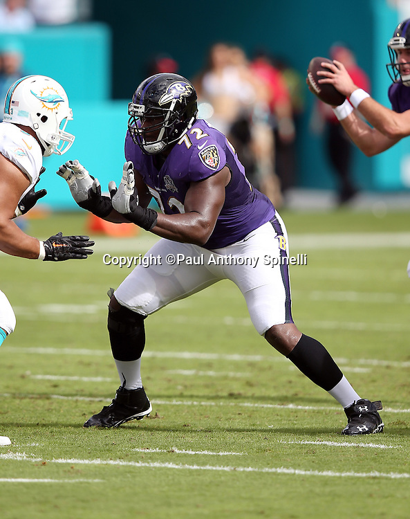 Baltimore Ravens guard Kelechi Osemele (72) pass blocks during the 2015 week 13 regular season NFL football game against the Miami Dolphins on Sunday, Dec. 6, 2015 in Miami Gardens, Fla. The Dolphins won the game 15-13. (©Paul Anthony Spinelli)