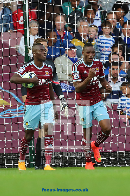 Diafra Sakho (right) celebrates after scoring the second goal of the Barclays Premier League match against Queens Park Rangers at the Boleyn Ground, London<br /> Picture by Richard Calver/Focus Images Ltd +447792 981244<br /> 05/10/2014
