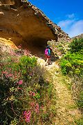 HIker in Lobo Canyon, Santa Rosa Island, Channel Islands National Park, California USA