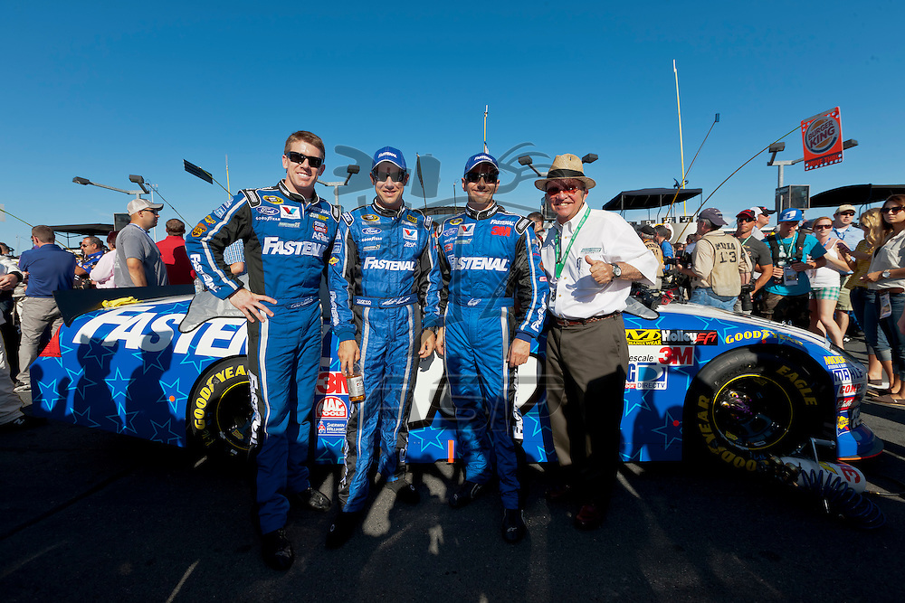 CONCORD, NC - MAY 27, 2012:  Carl Edwards (99), Matt Kenseth (17), Greg Biffle (16) and Jack Roush pose for a photo before the Coca-Cola 600 race at the Charlotte Motor Speedway in Concord, NC.