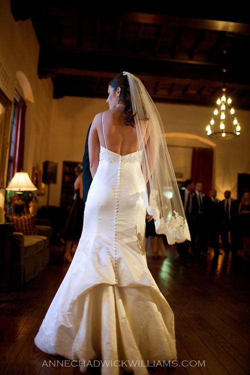 A bride at her wedding reception in the Sutter Club, Sacramento, California.