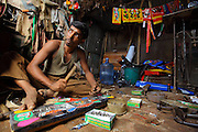Craftsman working on the body of a rickshaw in a small workshop located in Old Dhaka. This worker has been making rickshaws since he is 13 years old. (Dhaka, Bangladesh).