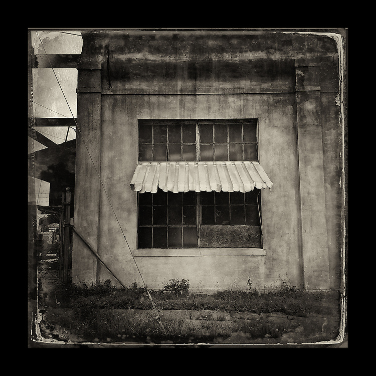 "Charles Blackburn image of Window and metal awning in Texarkana, TX. 5x5"" print."