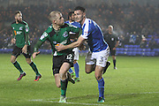 Scunthorpe United midfielder Neil Bishop (12) gets in a header at the near post during the League 1 match between Peterborough United and Scunthorpe United at London Road, Peterborough, England on 22 November 2016. Photo by Nigel Cole.