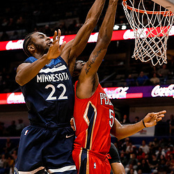Nov 29, 2017; New Orleans, LA, USA; Minnesota Timberwolves forward Andrew Wiggins (22) blocks a shot by New Orleans Pelicans guard E'Twaun Moore (55) during the second half at the Smoothie King Center. The Timberwolves defeated the Pelicans 120-102. Mandatory Credit: Derick E. Hingle-USA TODAY Sports