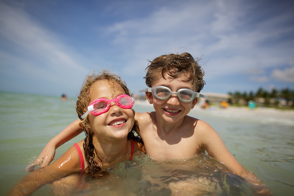 Children play in the water along the pristine beaches of Sanibel Island on the Gulf Coast of Florida.