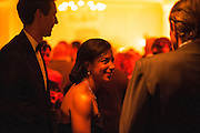 """Photo by Matt Roth.Assignment ID: 10137379A..Ian Cameron, left waits with his wife Susan Rice, the United States U.N. ambassador talks with a guest during Buffy and Bill Cafritz, Ann and Vernon Jordan, Vicki and Roger Sant's inaugural """"Bi-Partisan Celebration"""" at the Dolley Madison Ballroom at the Madison Hotel in Washington, D.C. on Sunday, January 20, 2013."""