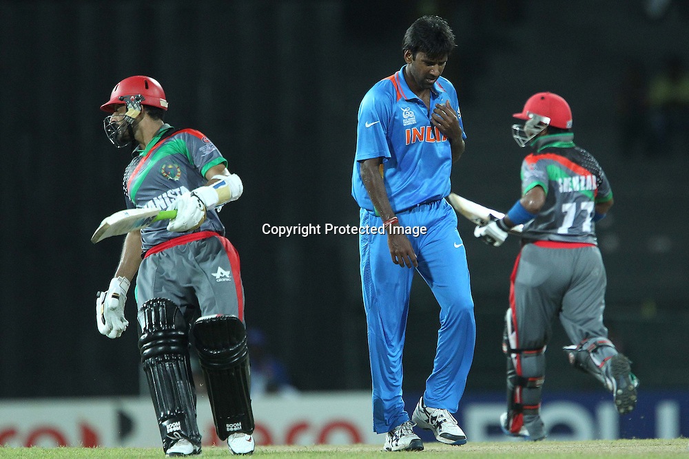 Lakshmipathi Balaji walks back as the runs are made during the ICC World Twenty20 match between India and Afghanistan held at the Premadasa Stadium in Colombo, Sri Lanka on the 19th September 2012<br /> <br /> Photo by Ron Gaunt/SPORTZPICS